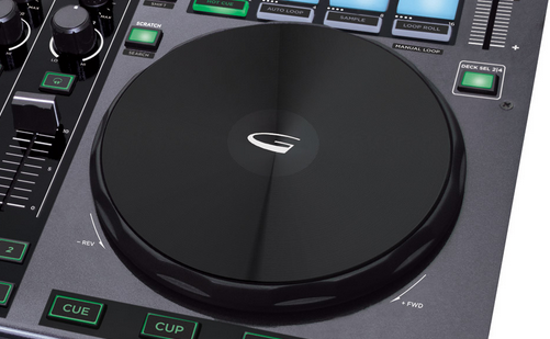 The jogwheels are large and weighted, with a mechanical top plate in the style of the Traktor Kontrol S4.